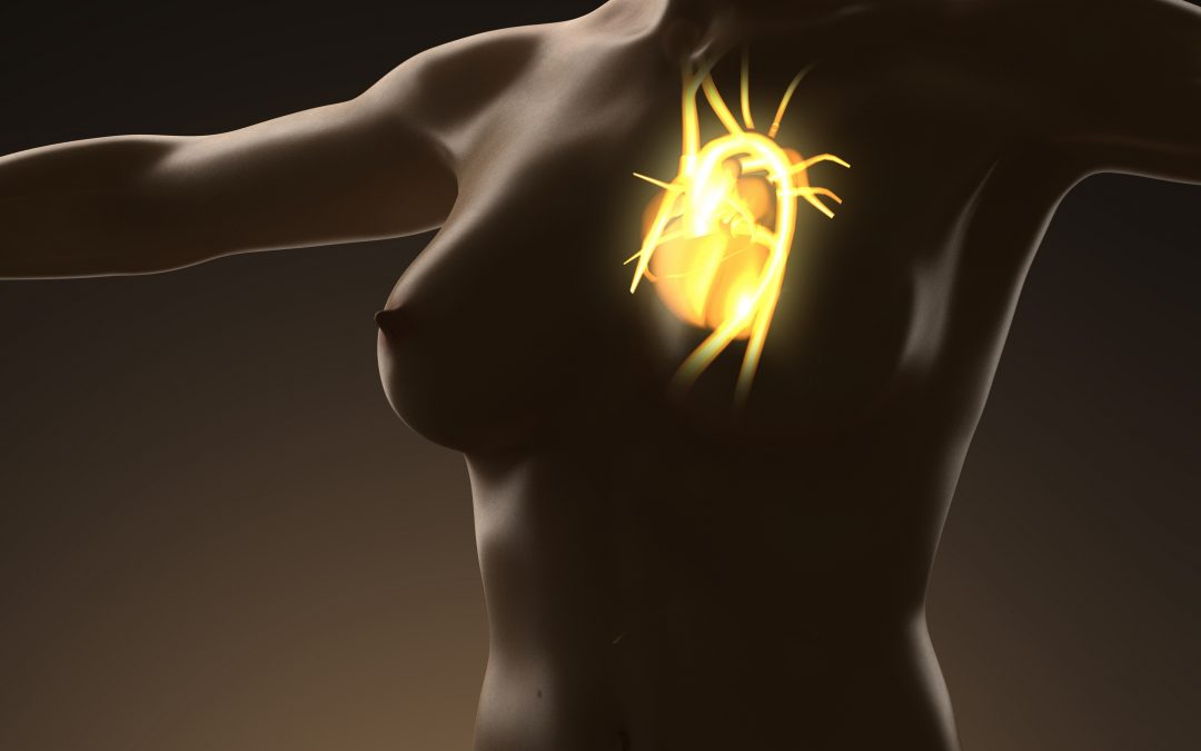 A naked womans body in shadow but with a glowing heart